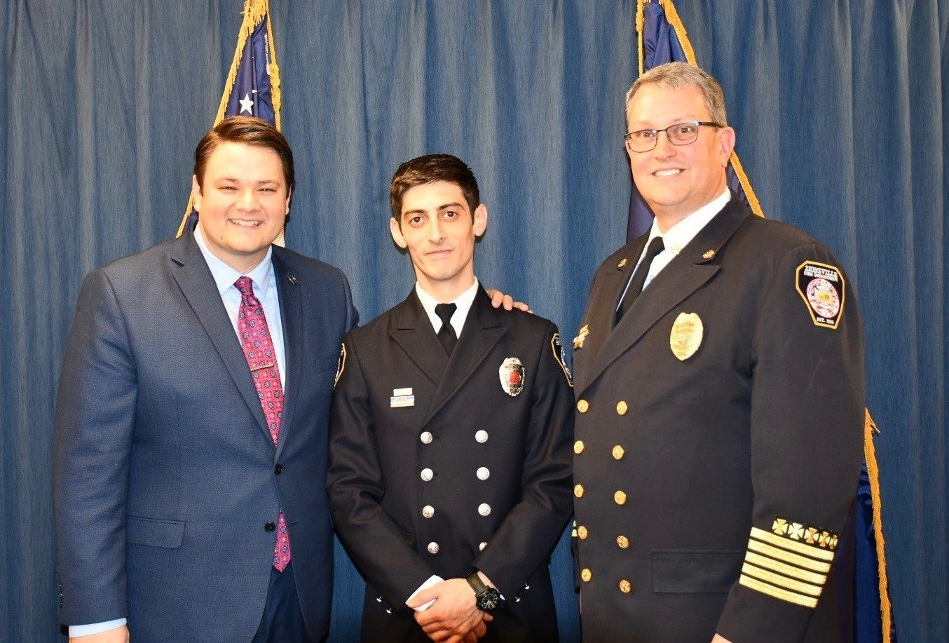 (from left to right): Sen. Ford, Firefighter Paramedic Abdullakh Abamislimov, Chief James VanGorder